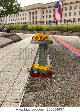 Arlington, Virginia, Usa - September 11 2018: Flowers On Benches At Pentagon Memorial Laid On 9 Sept