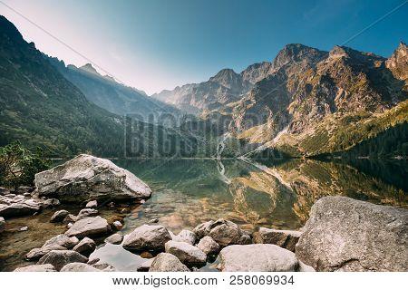 Tatra National Park, Poland. Famous Mountains Lake Morskie Oko Or Sea Eye Lake In Summer Morning. Fi