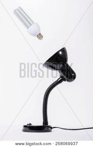 Led Lamp On Illuminated With Black Lamp Holder. White Background