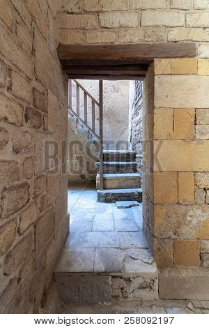 Ancient External Old Bricks Stone Wall And Doorway Revealing A Stone Staircase With Wooden Balustrad