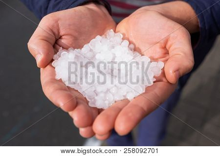 Hail In Caucasian Woman Hands After Hailstorm
