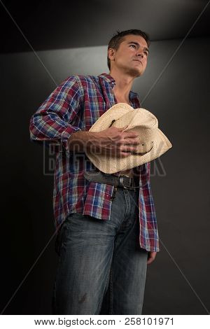 The Handsome Cowboy Poses For A Western Romance Book.