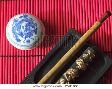 Chinese Calligraphy Set On Red Mat