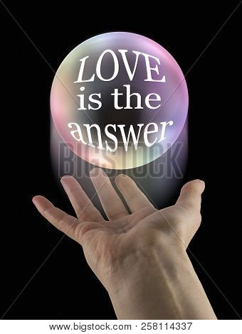 Whatever Your Question Love Is The Answer - Large Transparent Ball Floating Above An Open Palm Conta