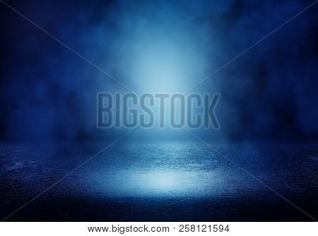 Background Of An Empty Room With Smoke And Neon Light. Dark Blue Abstract Background