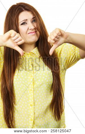 Negative Gestures Concept. Disappointed Young Woman Showing Thumb Down Hand Sign Gesture Looking Wit
