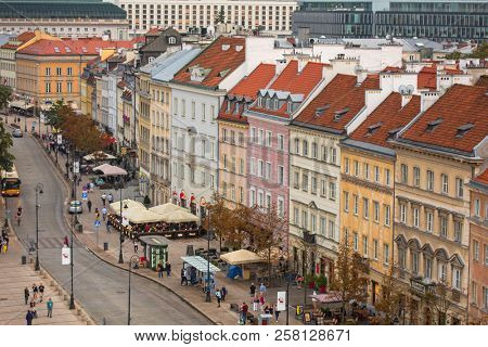 Warsaw, Poland - September 5, 2018: People on Krakowskie przedmiescie street in Warsaw city, Poland. This is one of the best known and most prestigious streets of Warsaw