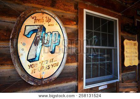 POLEBRIDGE, MONTANA, USA -  September 9, 2018: Vintage 7Up soda sign hangs on the exterior of Northern Lights Saloon