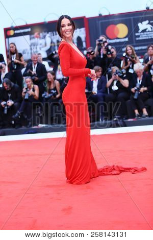Paola Di Benedetto walks the red carpet ahead of the 'One Nation One King (Un Peuple Et Son Roi)' screening during the 75th Venice Film Festival at Sala Grande on September 7, 2018 in Venice, Italy.