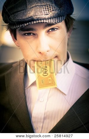 Man Eating And Consuming His Cash Earnings
