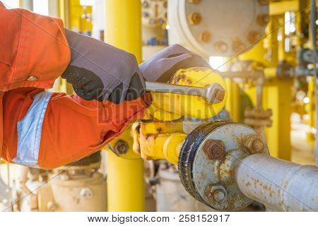 The Production Operator Adjusting Pressure Regulator Of Instrument Gas Supply System, Offshore Oil R