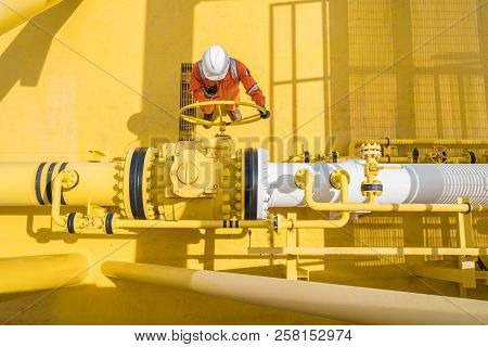 Production Operator Communicate Between Central Control Room By Using Radio To Operate Ball Valve At