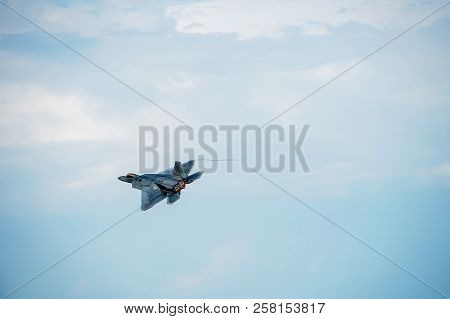 Oshkosh, Wi - 28 July 2018:  A F-22 Flying With Afterburner Creating Contrails At An Airshow.