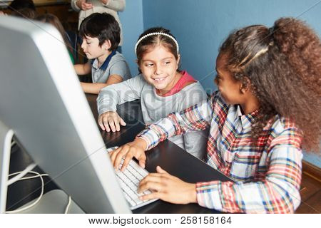 In elementary school computer science girls learn together at the computer