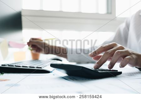 Close Up Business Woman Using Calculator  For Do Math Finance In Office And Business Working Backgro