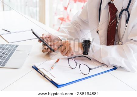 Medical Doctor Working On Smartphone. Medical Technology Concept.