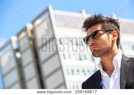 Sexy Gorgeous Stylish Man. Sunglasses. City Style. A Beautiful And Charming Man With Sunglasses Outd