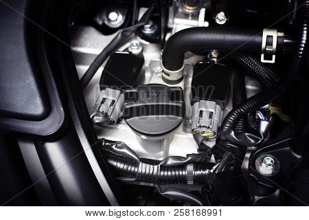 Engine oil cap installed on a car engine for maintenance service lubricant, automotive part concept. poster