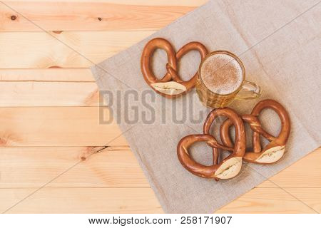 Beer Mug And Pretzels On Wooden Table. View With Copy Space