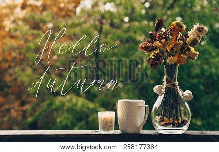 Hello Autumn. Cozy Autumn Still Life: Cup Of Hot Coffee With Autumn Bouquet Of Flowers On Vintage Wi