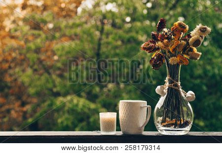 Cozy Autumn Still Life: Cup Of Hot Coffee With Autumn Bouquet Of Flowers On Vintage Windowsill With