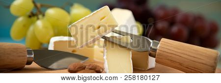 Slices Of Cheese Camembert With Raspberries And Nuts