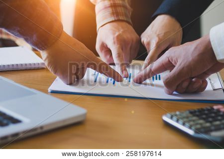 Business Meeting On The Wooden Table. Working Area. Hand Pointing To Graf.