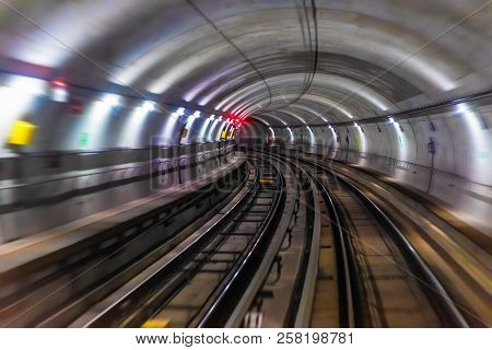 Riding The Train In Subway Metro Underground Tube Tunnel Illuminated Railroad Track With Motion Blur