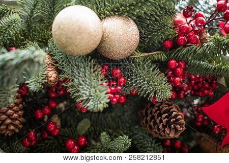 Christmas Decoration. Christmas Decoration. Berries, Cones And Ribbons Decorate Festive Spruce