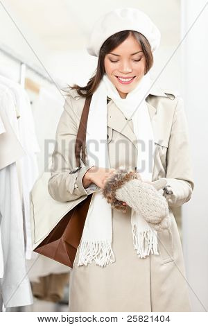 Shopping Woman Trying Winter Gloves