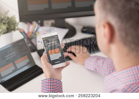 Designer Working On Responsive Web Design Project. Web Developer And Programmer Working In Office Wi