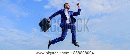 Success in business demands supernatural efforts. Businessman with briefcase jump high in motion forward. Businessman formal suit make effort to succeed blue sky background. Supernatural power poster