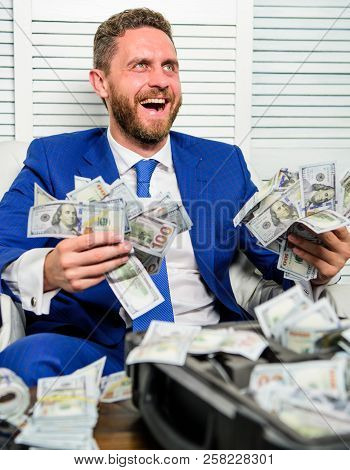 Man Cheerful Happy Businessman With Pile Dollar Banknotes. Profit And Richness Concept. Businessman