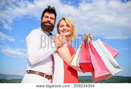 Family Bought Excellent Clothes. Shopping Brings Positive Emotions. Couple With Luxury Bags Hugs Blu