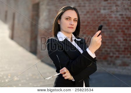 Businesswoman Holding Phone And Glasses