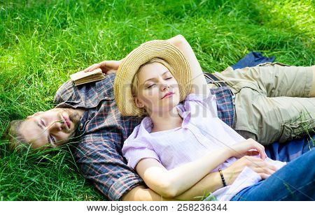 Guy And Girl Dreamy Sleepy Enjoy Tranquility Nature. Couple In Love Having Nap Outdoors. Time For Na