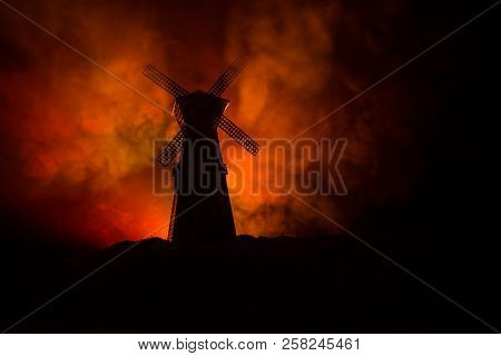 Windmill Silhouette Standing On Hill Against The Night Sky. Night Decor With Old Windmill On Hill Wi