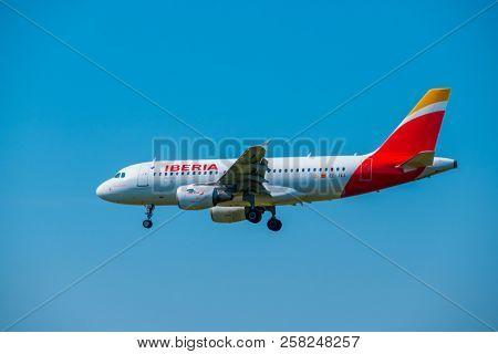 Zurich, Switzerland - July 19, 2018: Iberia airlines airplane preparing for landing at day time in Zurich nternational airport