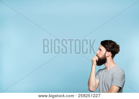 Thoughtful Contemplative Man Looking Sideways Perplexed By Smth On The Left. Free Space For Advertis