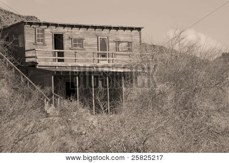 Old mining cabin in sepia