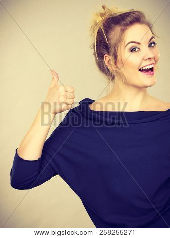 Happy Positive Blonde Woman Showing Thumb Up Gesture. Good Gestures And Human Face Expressions Conce