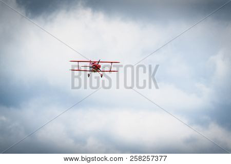 Vintage Red Propeller Plane Flying On A Blue Sky With Front