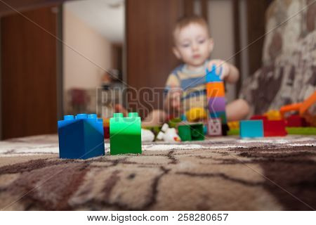 Sweet Little Boy Building Tower From Cubes At Home