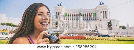 Europe vacation banner Italy tourist Asian woman taking travel photo with vintage camera at Monumento Nazionale vittorio emanuele ii,The Altare della Patria, or Il Vittoriano, Rome, Italy.