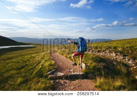 Tourist Friends On A Top Of Mountains In A Scottish Highlands. Scotland Nature. Tourist People Enjoy