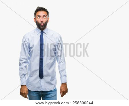 Adult hispanic business man over isolated background making fish face with lips, crazy and comical gesture. Funny expression.