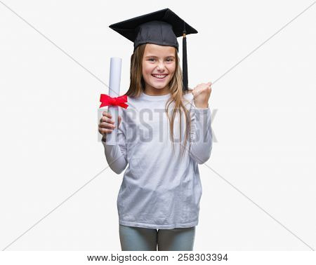 Young beautiful girl wearing graduate cap holding degree over isolated background screaming proud and celebrating victory and success very excited, cheering emotion