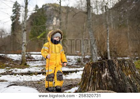Little Boy Playing On Nature In Windy And Cold Day Winter Day. Child Walk In Snowy Park