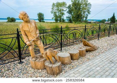 Wooden Sculpture Of A Fisherman On The Embankment Of Galichsky Lake September 11, 2018, Galich, Kost