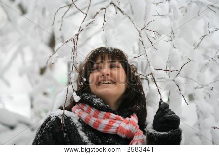Young Woman Under A Falling Snow
